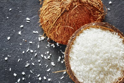 Coconut shreds on a dark slate background