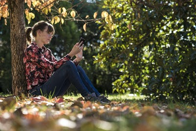 Young woman reading something on a digital device