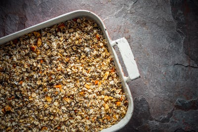 Granola mixture in a baking dish diagonal