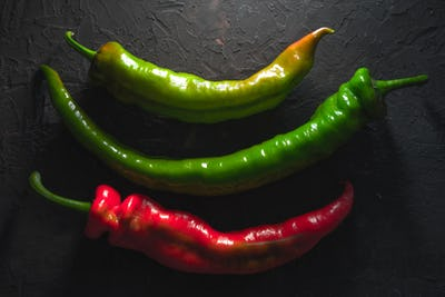 Multicolored chilli in the center of the table