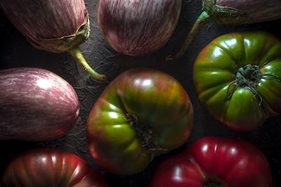 Background of large colored tomatoes and aubergines
