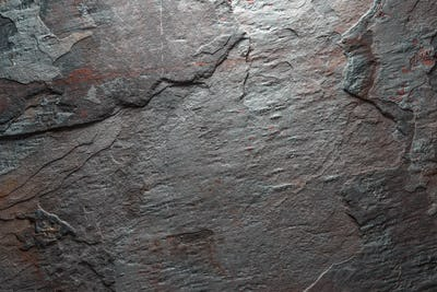 Background of gray with brown colored stone
