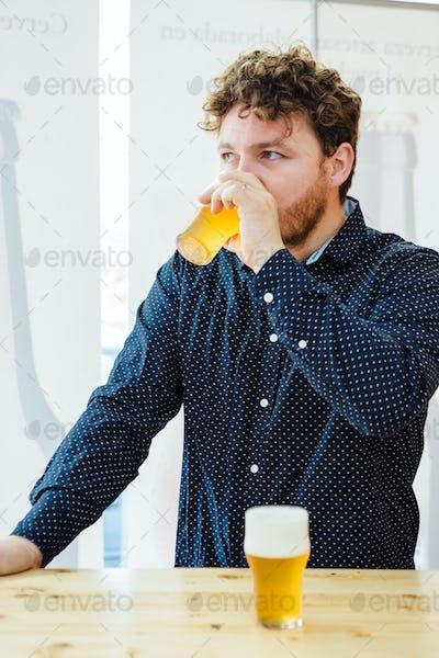 Bearded man drinking craft beer