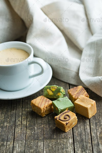 Colorful caramel candies and coffee cup.
