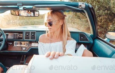Girl posing in a convertible