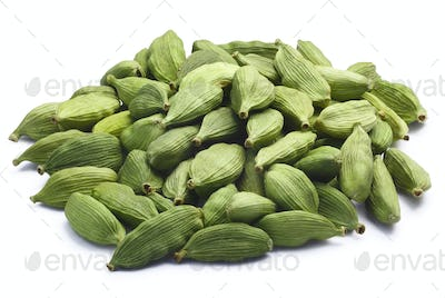Pile of dried green cardamom pods, paths