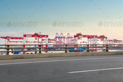 container port with road at dusk