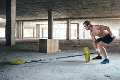 Man lifting weight on crossbar