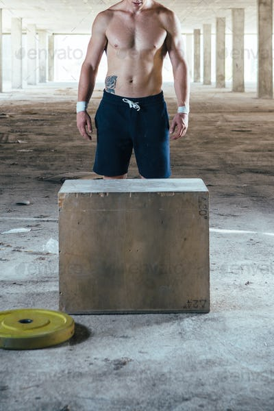 Man standing near wooden box