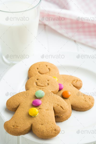 Sweet gingerbread men and glass of milk.