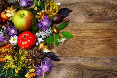 Happy Thanksgiving decor with golden acorn on wooden background