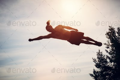 Young man levitating in the air.