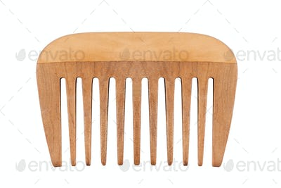 small wooden comb isolated on white