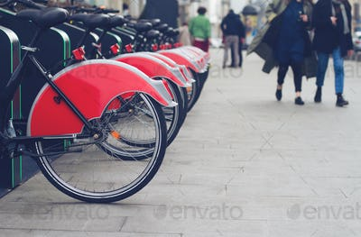 city bike stand with red bicycles