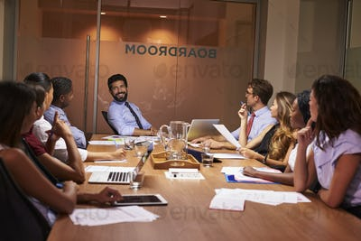 Relaxed moment at an evening corporate business meeting