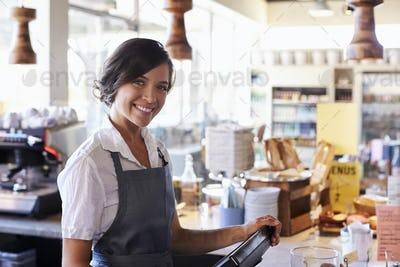 Portrait Of Female Employee Working At Delicatessen Checkout