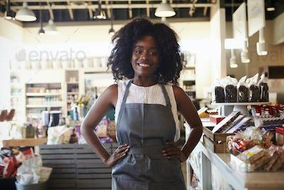 Portrait Of Female Employee Working In Delicatessen