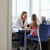 Pediatrician Talking To Child In Hospital
