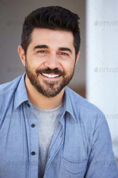 Outdoor Head And Shoulders Portrait Of Smiling Mature Man