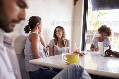 Young adults relaxing at a coffee shop, close up