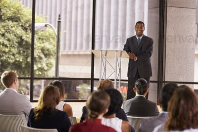 Black businessman presenting seminar smiling to audience