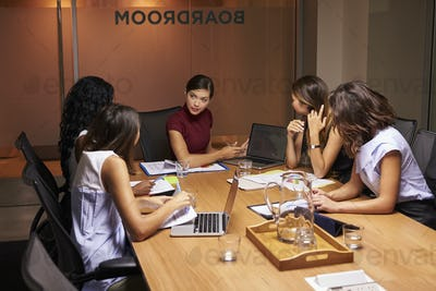 Businesswomen talking at an evening meeting in a boardroom