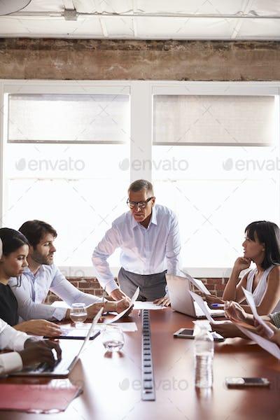 Mature Businessman Addressing Boardroom Meeting