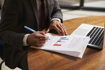Businessman preparing a document, mid section, close up