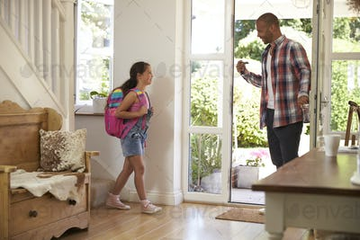 Girl Leaving Home For School With Father