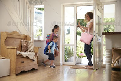 Children Leaving Home For School With Mother