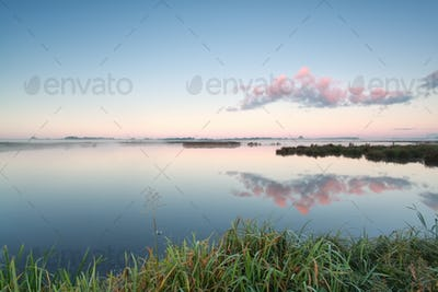 cloud reflection in lake at sunrise