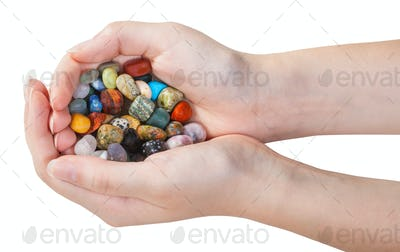 many various gemstones in handful isolated