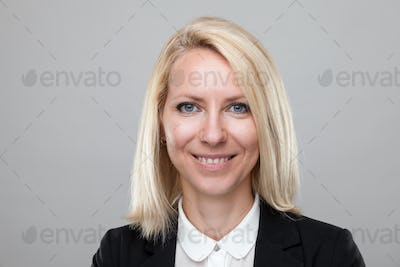 Headshot of young and happy business woman