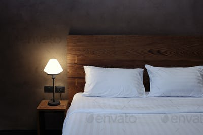 Desk lamp with pillow and bed
