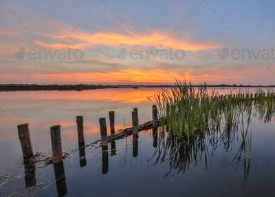 Sunset over lake with bank protection
