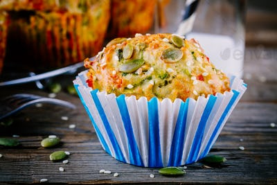 muffins with spinach,  feta cheese pumpkin seeds and sesame seeds
