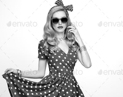 Fashion Blond Girl in Polka Dots Dress. Outfit