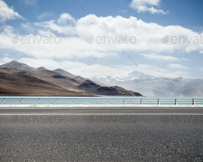 road with holy lake in tibet