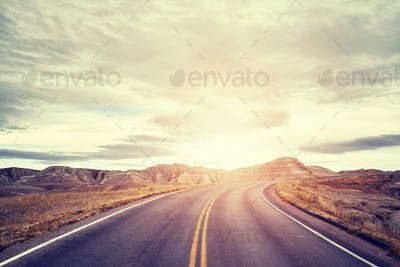Picturesque road at sunset, travel concept background.