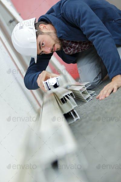 Worker viewing plastic framework