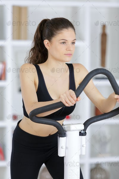 Young lady using fitness equipment