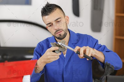 Mechanic working on car part