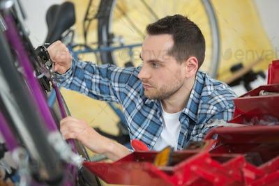 Mechanic working on bicycle gears