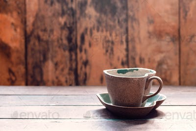 Cup and saucer on wooden