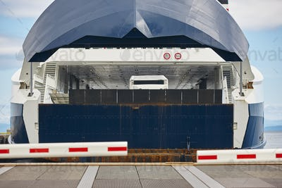 Norwegian car ferry landing at port. Closed barrier. Horizontal