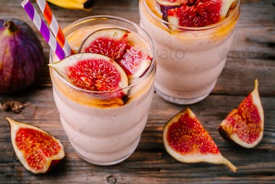 healthy breakfast smoothie with fresh figs, banana and honey in glasses
