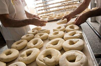 Bakers preparing dough for bagels