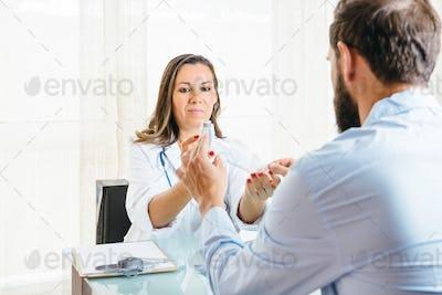 Doctor helps a patient