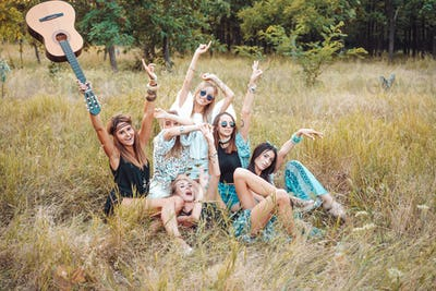 Six girls in nature have fun