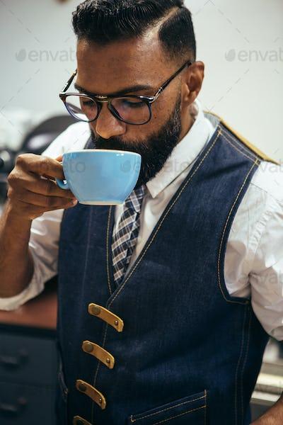 Afro-American man drinking coffee